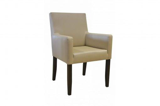 Masívna stolička Bruce, pripomínajúca kreslo, v koženom čalúnení.