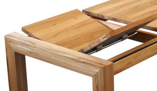 Rozkladací jedálenský stôl KOMO pri vysúvaní prídavných dosiek.