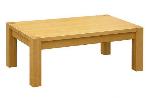 Celomasívny stolík Kubko s nohami prechádzajúcimi cez plát poskytuje bezprostredný kontakt s drevom, dizajn: Alojz Karpiš.